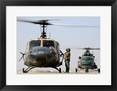Framed Iraqi air force carries wounded warrior on aeromedical evacuation mission Print