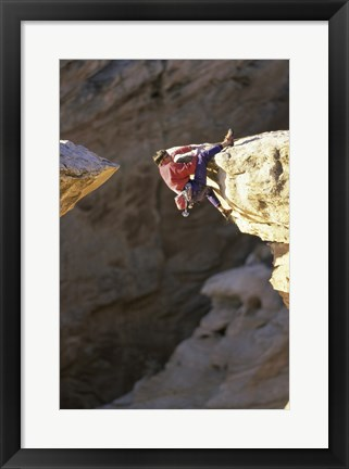 Framed High Angle View of a Man hanging off of a Summit Print