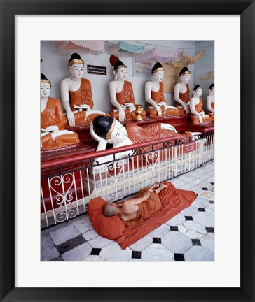 Framed Monk Sleeping in Front of Buddha Statues Print