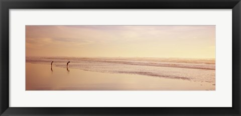 Framed Two children playing on the beach, San Francisco, California, USA Print