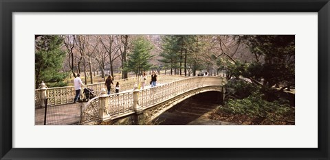 Framed Group of people walking on an arch bridge, Central Park, Manhattan, New York City, New York State, USA Print
