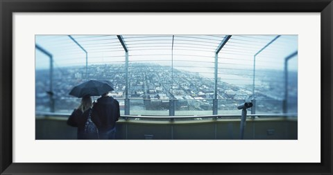 Framed Couple viewing a city from the Space Needle, Queen Anne Hill, Seattle, Washington State, USA Print