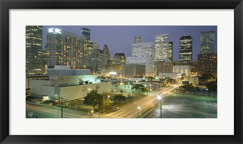 Framed Skyscrapers lit up at night, Houston, Texas Print