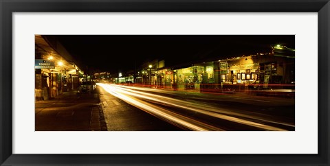Framed Streaks of lights on the road in a city at night, Lahaina, Maui, Hawaii, USA Print