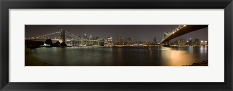Framed Brooklyn Bridge and Manhattan Bridge across East River at night, Manhattan, New York City, New York State, USA Print
