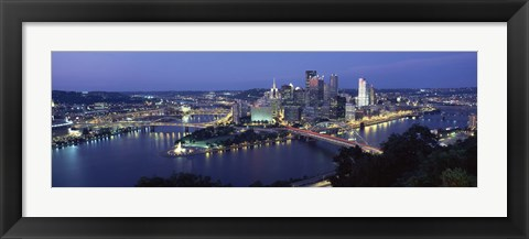 Framed Buildings along a river lit up at dusk, Monongahela River, Pittsburgh, Allegheny County, Pennsylvania, USA Print