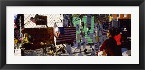 Framed Side profile of a woman standing in front of chain-link fence at a memorial, New York City, New York State, USA Print