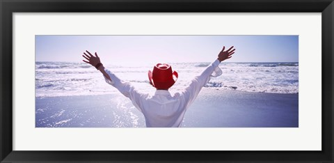 Framed Woman With Outstretched Arms On Beach, California, USA Print
