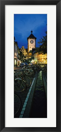 Framed Bicycles parked along a stream near a road, Freiburg, Baden-Wurttemberg, Germany Print
