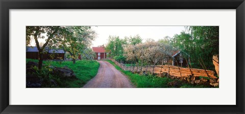Framed Dirt road leading to farmhouses, Stensjoby, Smaland, Sweden Print