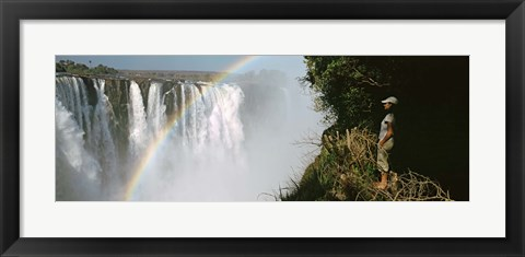 Framed Woman looking at a rainbow over the Victoria Falls, Zimbabwe Print
