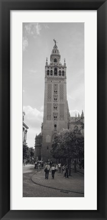 Framed Group of people walking near a church, La Giralda, Seville Cathedral, Seville, Seville Province, Andalusia, Spain Print