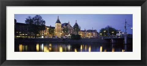 Framed Reflection of a railway station in water, Amsterdam Central Station, Amsterdam, Netherlands Print