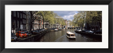 Framed Close up of Boats in a canal, Amsterdam, Netherlands Print