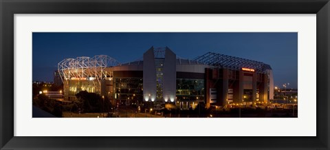 Framed Football stadium lit up at night, Old Trafford, Greater Manchester, England Print