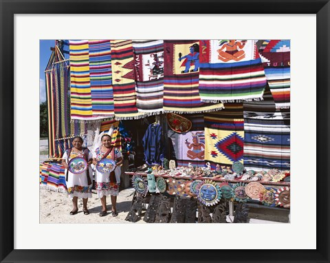Framed Two female vendors dressed in Mayan costumes displaying products Print