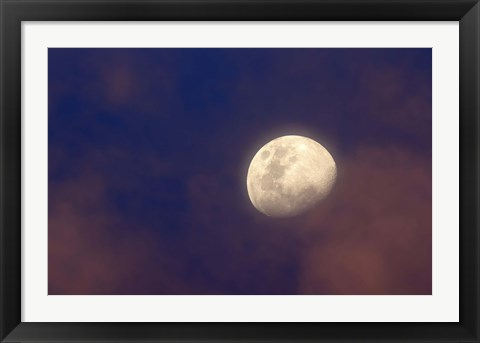 Framed moon between colorful clouds at sunset Print