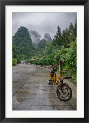 Framed Bicycle sits in front of the Guilin Mountains, Guilin, Yangshuo, China Print