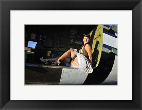 Framed Sexy 1940's style pin-up girl sitting inside of a C-47 Skytrain aircraft Print