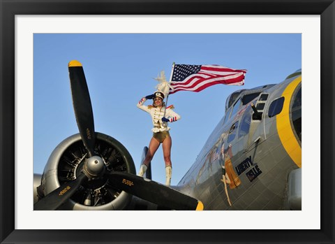 Framed 1940's style majorette pin-up girl on a B-17 bomber with an American flag Print
