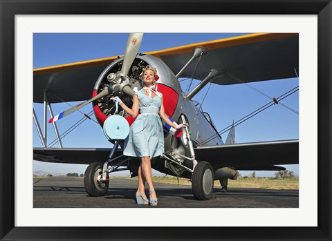 Framed Elegant 1940's style pin-up girl standing in front of an F3F biplane Print