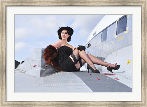 Framed Glamorous woman in 1940's style attire sitting on a vintage aircraft Print