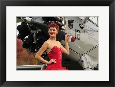 Framed Redhead pin-up girl in 1940's style dancer attire holding on to a vintage aircraft propeller Print