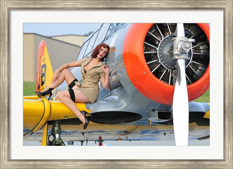 Framed 1940's style pin-up girl posing on a T-6 aircraft Print