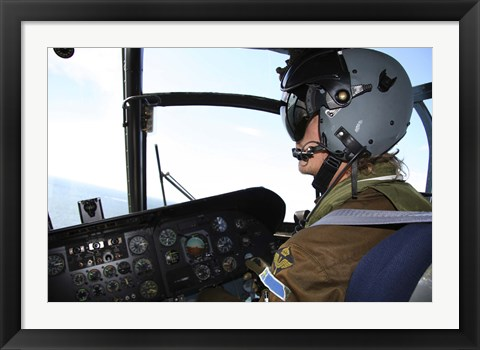 Framed Pilot in the cockpit of a CH-46 Sea Knight helicopter of the Swedish Air Force Print