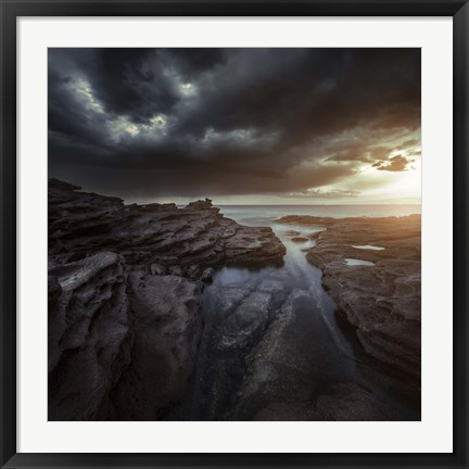 Framed Huge rocks on the shore of a sea against stormy clouds, Sardinia, Italy Print