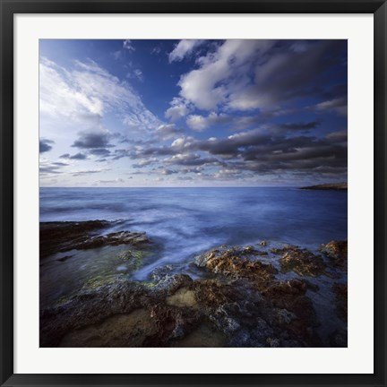 Framed Tranquil lake and rocky shore against cloudy sky, Crete, Greece Print