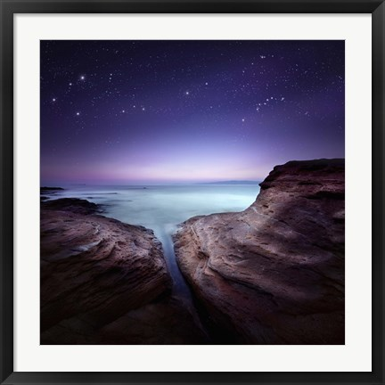 Framed Two large rocks in a sea, against starry sky Print