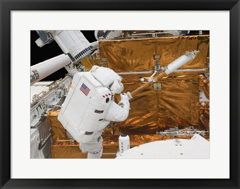 Framed Astronaut works with the Hubble Space Telescope in the cargo bay of Atlantis Print