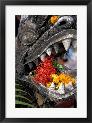 Framed Flower Offerings in Stone Dragon's Mouth, Laos Print
