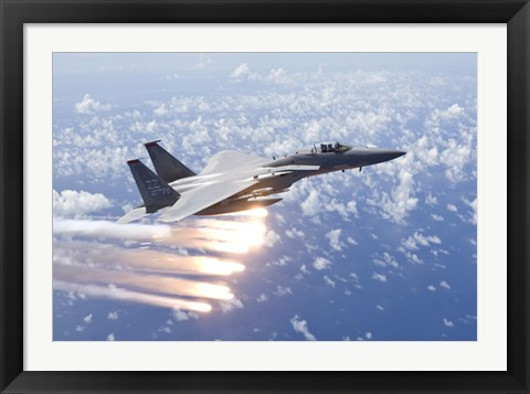 Framed F-15 Eagle Releases Flares over the Pacific Ocean Print