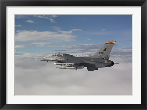 Framed F-16 Fighting Falcon Flies with AGM-65 Maverick Missile Print