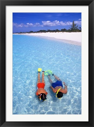 Framed Snorkeling in the blue waters of the Bahamas Print