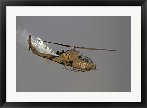 Framed AH-1S Tzefa of the Israeli Air Force dispenses flares Print