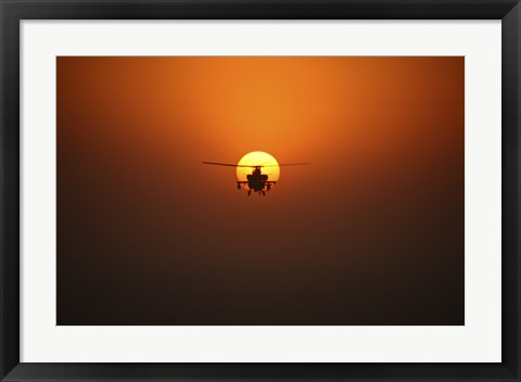 Framed AH-64D Apache Helicopter Flying into the Sun over Iraq Print