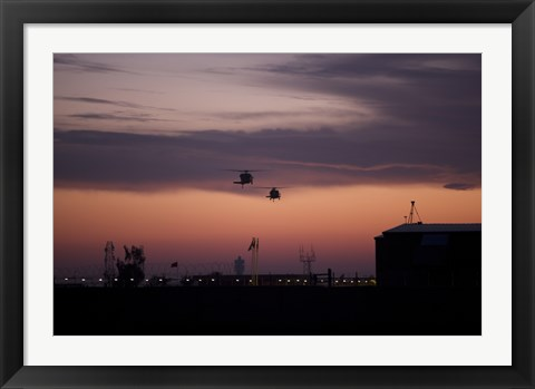 Framed pair of UH-60 Black Hawk helicopters approach their Landing in Baghdad, Iraq Print