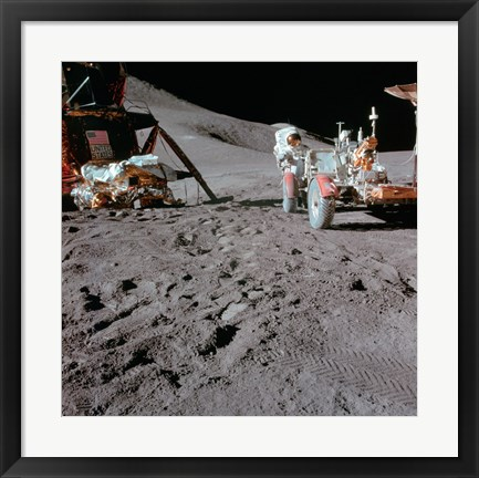 Framed Apollo 15 Astronaut Works at the Lunar Roving Vehicle on the Moon Print