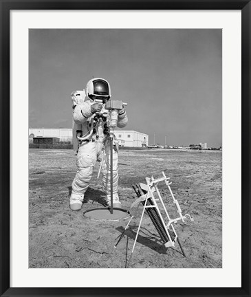 Framed Apollo 13 astronaut walks through procedures at the Kennedy Space Center Print