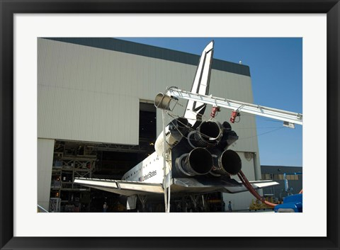 Framed Space shuttle Discovery is towed into Bay at the Orbiter Processing Facility Print