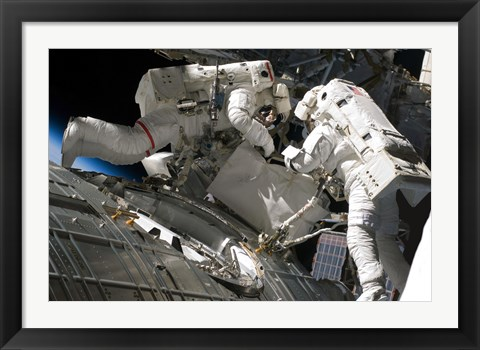 Framed Astronauts participate in extravehicular activity Print
