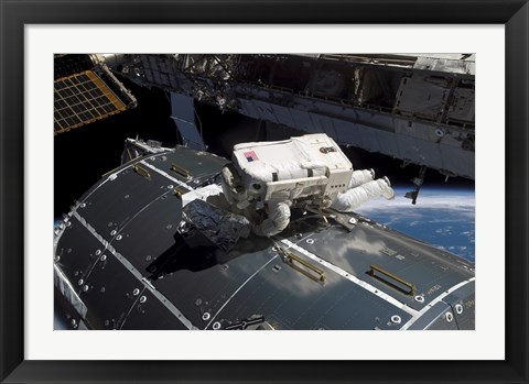 Framed Astronaut Works on the new Columbus Laboratory During a Spacewalk Print
