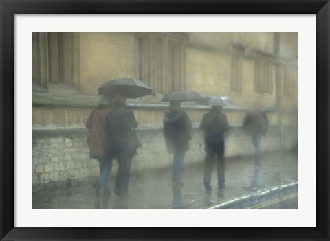 Framed Walking in the rain, Oxford University, England Print