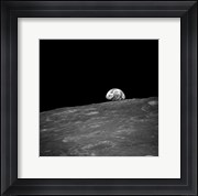 The first photograph taken by humans of Earthrise during Apollo 8.