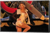 Framed 1940's pin-up girl posing with a vintage T-6 Texan aircraft