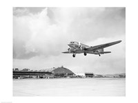 Framed Low angle view of a military airplane landing, Douglas DC-3