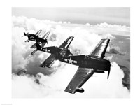 Framed High angle view of four fighter planes flying in formation, F6F Hellcat